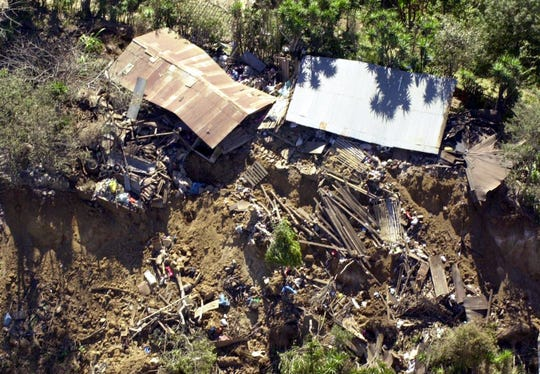 El Salvador also suffered a major earthquake in 2001, resulting in mudslides that left many communities damaged and cut off from the rest of the country. (AP Photo/Victor Ruiz)