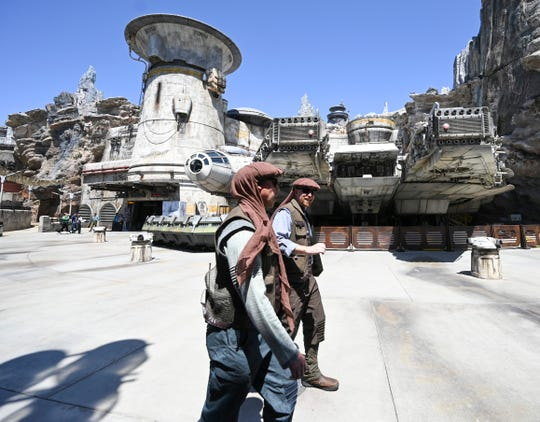 Everyone from merchants to maintenance workers are dressed in galaxy-far-away garb. And don't call them cast members.