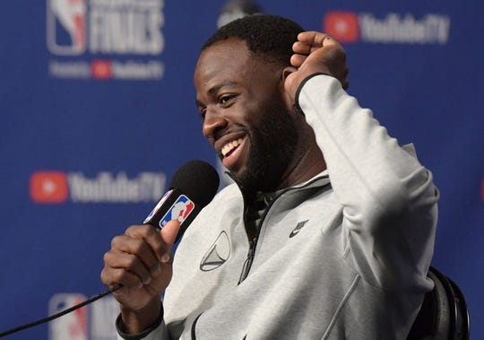 Draymond Green answers questions during media day Wednesday.
