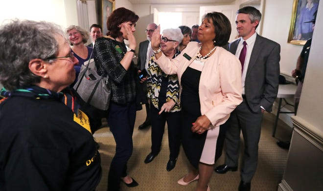 State Sen. Melanie Levesque, D-Hillsborough, right, is congratulated following a vote on the death penalty at the State House in Concord, N.H., Thursday, May 30, 2019. (AP Photo/Charles Krupa)