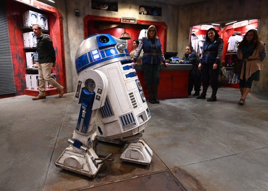R2-D2 rolls through Droid Depot at Star Wars: Galaxy's Edge.