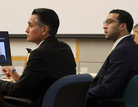 Kellen Winslow Jr. sits with his attorney Marc Carlos during his rape trial.