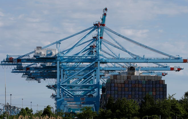 In this May 10, 2019 photo a container ship is loaded at the Virginia International Gateway terminal in Norfolk, Va. On Thursday, May 30, the Commerce Department issues the second estimate of how the U.S. economy performed in the January-March quarter.
