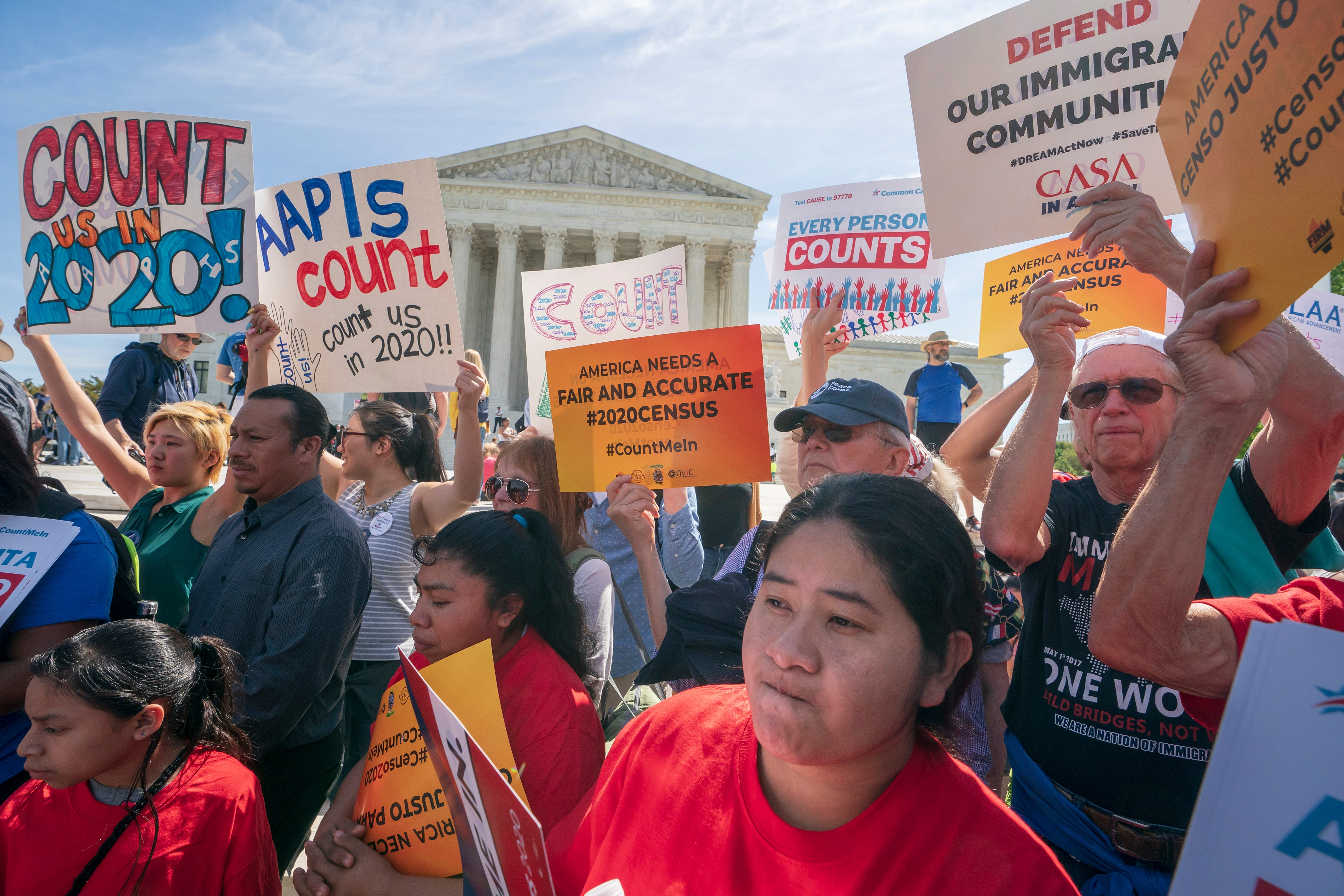 Immigration activists rally outside the Supreme Court in April as the justices hear arguments on the Trump administration's plan to ask about citizenship in the 2020 census.