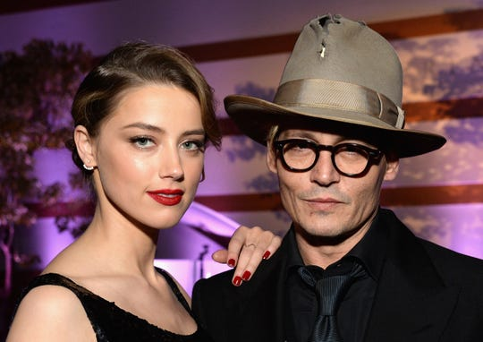 Johnny Depp and then-wife Amber Heard attending a 2014 Los Angeles gala.