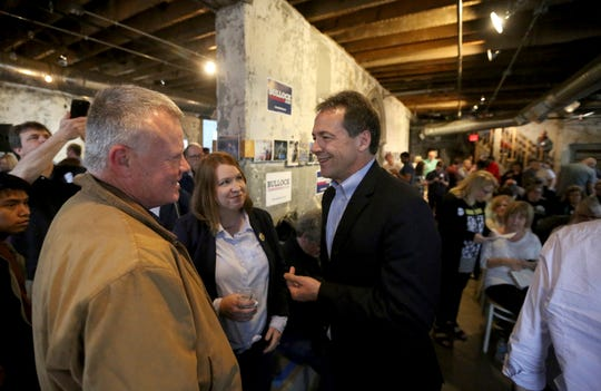 Democratic presidential candidate Steve Bullock, in the dark suit, in Dubuque, Iowa, on May 17, 2019.