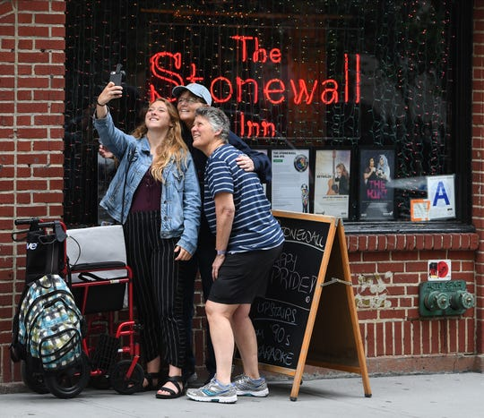 Kelly DeWeese takes a selfie in front of the the Stonewall Inn with her two moms, Linda Quinn and Karen DeWeese while they were visiting from Calif.