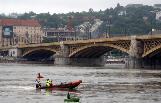 A rescue boat searches for survivors on the River Danube in Budapest, Hungary, Thursday, May 30, 2019. A massive search was underway on the river for missing people after the sightseeing boat with South Korean tourists sank after colliding with another vessel during an evening downpour.