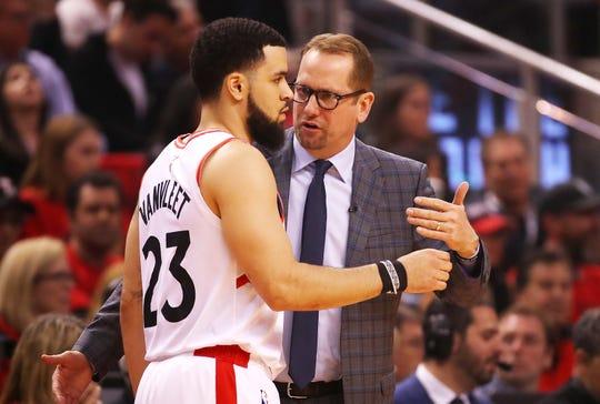 Fred VanVleet of the Toronto Raptors talks to head coach Nick Nurse.