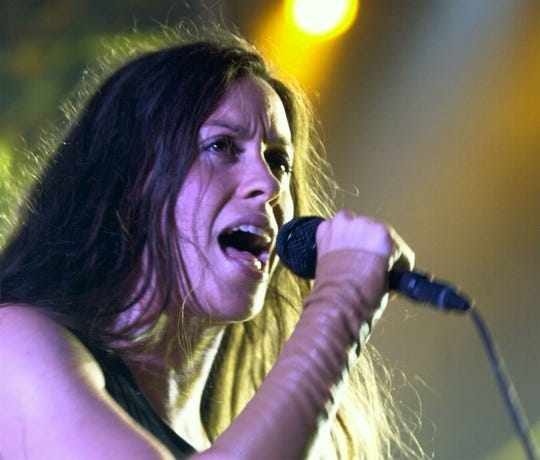 """Alanis Morisette performs on Aug. 10, 2002, in Frankfurt, Germany. Morissette announced Monday a 25th anniversary tour dedicated to her 1995 Grammy Award-winning debut album, """"Jagged Little Pill."""""""