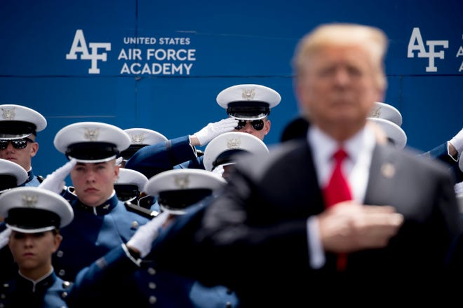 President Donald Trump, foreground right, participates in U.S. Air Force Academy graduation ceremonies.