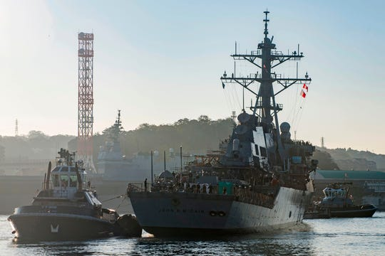 In this file photo released by the US Navy on November 27, 2018 the Arleigh Burke-class guided missile destroyer USS John S. McCain (DDG 56) is pulled towards a pier after departing from a dry dock at Fleet Activities Yokosuka, Japan. (AFP PHOTO / US NAVY / MASS COMMUNICATION SPECIALIST 2ND CLASS JEREMY GRAHAM )