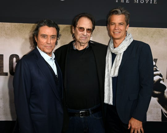 """Ian McShane, left, David Milch and Timothy Olyphant arrive for the premiere of HBO's """"Deadwood"""" in May in Los Angeles."""