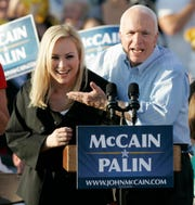 FILE - In this Aug. 30, 2008, file photo, former Republican presidential candidate, Sen. John McCain, right, introduces his daughter Meghan at a campaign stop in Washington, Pa. John McCain, the war hero who became the GOP's standard-bearer in the 2008 election, died Saturday, Aug. 25, 2018. He was 81. (AP Photo/Keith Srakocic, File) ORG XMIT: NYSB622