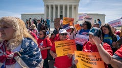 Immigration activists rallied outside the Supreme Court in April as the justices heard arguments over the Trump administration's plan to ask about citizenship on the 2020 census.