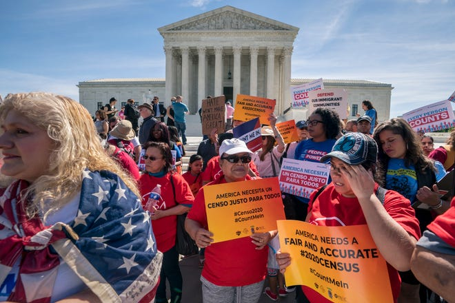 Immigration activists rallied outside the Supreme Court in 2019 as the justices heard arguments over the Trump administration's plan to ask about citizenship on the 2020 census.