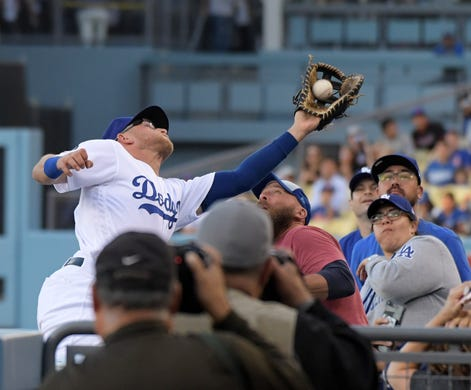 7d27cfffd May 29  Los Angeles Dodgers first baseman Matt Beaty attempts to catch a  foul ball