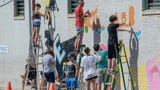 Legacy mural by 25 students from Southwood Academy of Art on LOT project buiding wall