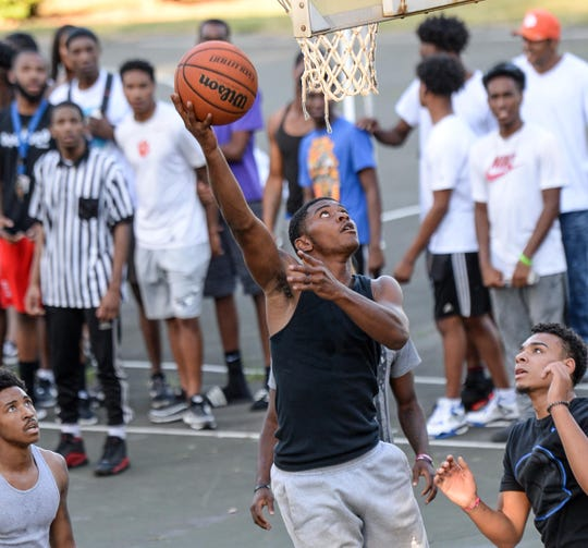 Graduating senior Tim Johnson of Westside scores during a basketball tournament at DB Walker Park in Eastside community fo Anderson Friday. The tournament, with sponsor help for food and drinks, drew local children, and City of Anderson officials.