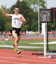 Rosholt's Adam Rzentkowski crosses the finish line to win the 3,200-meter run in Division 3 during the WIAA state track and field meet Friday in La Crosse.