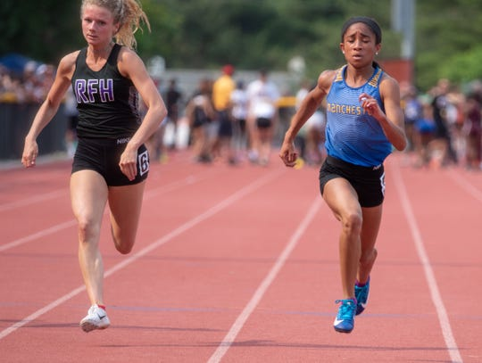 Manchester's Jada Ellis (right) edges Rumson-Fair Haven's Lily Orr in the Group 3 girls 100 dash.