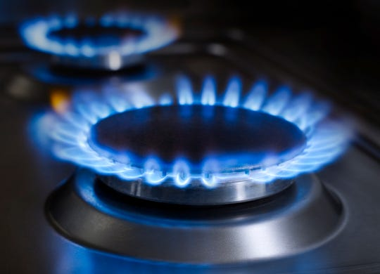 Blue flames from gas stove burner.