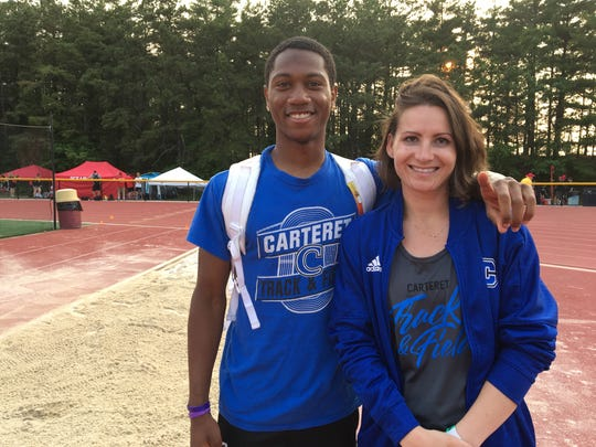 Carteret's  Stephon Kelley-Gordon with coach Kristen Johnson after the record-setting triple jump.
