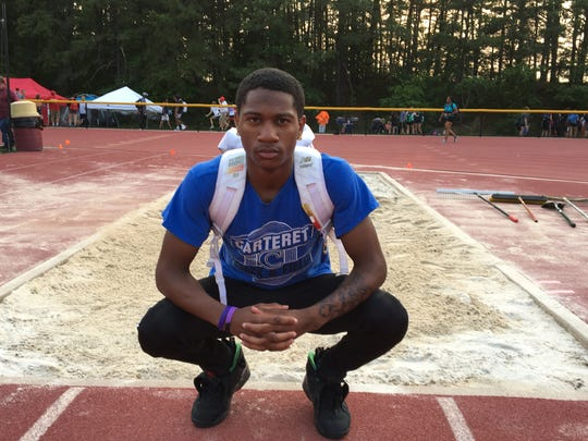 Carteret's Stephon Kelley-Gordon poses after winning the Group 2 boys triple jump