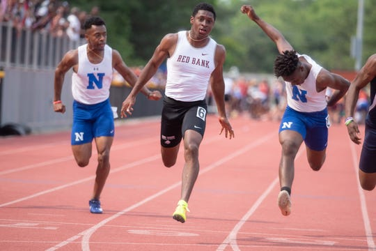 Red Bank's Nigel Mitchell (center) wins the Group 3 boys 100 dash