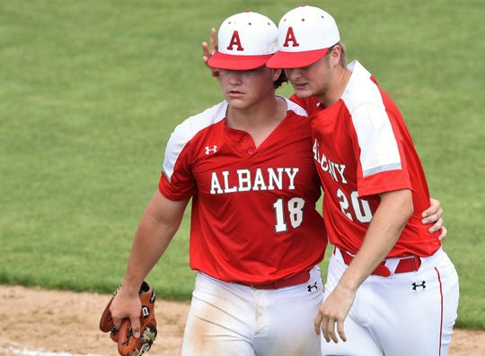 Albany's Ryan Hill, right, congratulates Josh Dyer after winning 7-6 in Game 2 of the Region I-2A final series against New Deal at Moffett Field in Snyder on Friday. Dyer got the final five outs in the victory and Hill collected a base hit in his only at bat.