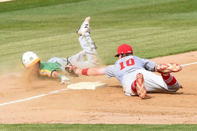 Albany third baseman Jackson Chapman (10) reaches to tag out a New Deal runner attempting to steal third during Game 1 of the Region I-2A final series at Moffett Field in Snyder on Thursday, May 30, 2019.