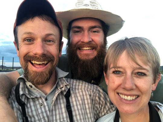 Jay Packer, Christian Walker, and Amy Packer share a smile during Walker's recent visit to bird in Taylor County in early May.