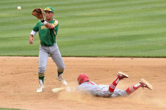 Albany's Cade Neve (7) slides safely into second with a stolen base ahead of the throw against New Deal in Game 1 of the Region I-2A final series at Moffett Field in Snyder on Thursday, May 30, 2019.