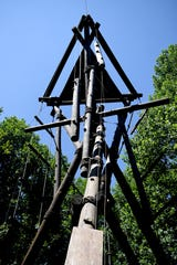 "The Alpine Tower at North Carolina Outward Bound's Cedar Rock Base Camp is like a ""choose your own adventure"" structure according to climbing program manager Spencer Huffman. Climbers have a number of ways to reach the top after they climb one of the three poles on the ground."