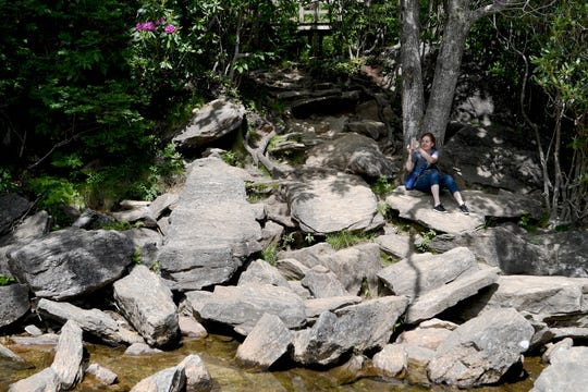 Cecile Gogol, of New York, takes a photo of her friend at the bottom of a waterfall at Graveyard Fields on the Blue Ridge Parkway on May 30, 2019.