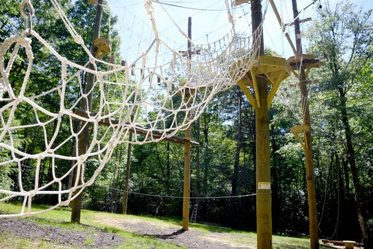 The challenge course at North Carolina Outward Bound's Cedar Rock Base Camp is entered by climbing up a large cargo net onto the structure. Outward Bound uses high ropes courses for educational purposes only.