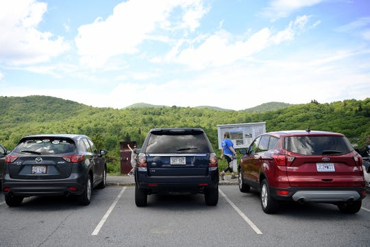 Vehicles with license plates from Illinois, Wisconsin and Missouri were parked at Graveyard Fields on the Blue Ridge Parkway on May 30, 2019.