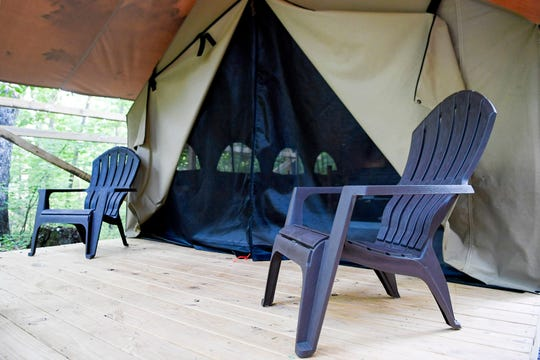 Chairs on the porch of a glamping tent at Lake Powhatan May 25, 2019.