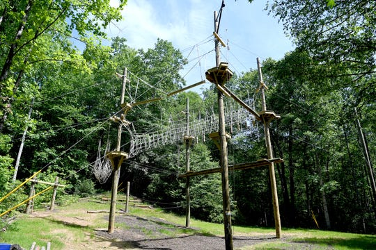 The challenge course at North Carolina Outward Bound's Cedar Rock Base Camp features nets, ropes, small platforms and a large swing. Outward Bound uses high ropes courses for educational purposes only.