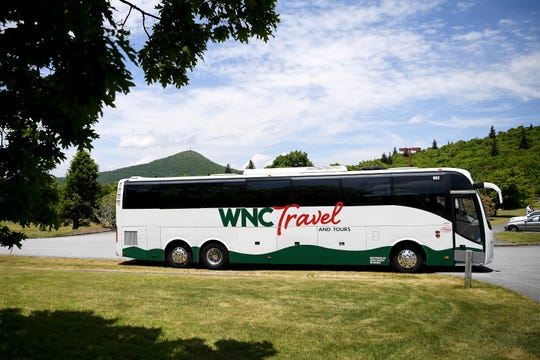 A tour bus waits in the parking lot of the Pisgah Inn on the Blue Ridge Parkway on May 30, 2019.