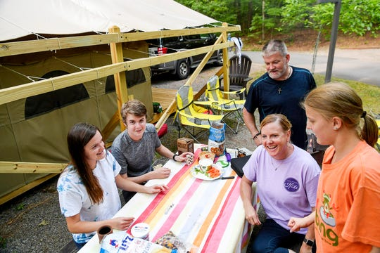 From left, Joslyn, Luke, Tommy, Cheryl and Jordan Halcom spend time together at their glamping campsite at Lake Powhatan May 25, 2019.