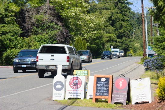 Advertising boards for businesses in the Coppertop development sit along Sportsman Club Road on Bainbridge Island.