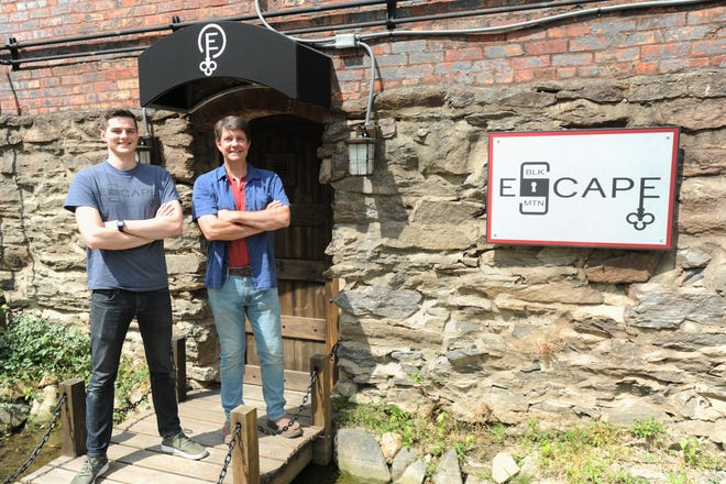 A.J. Stewart, left, and Jon Brooks opened Black Mountain Escape in the basement of the town's oldest building, The Junction, on May 27.