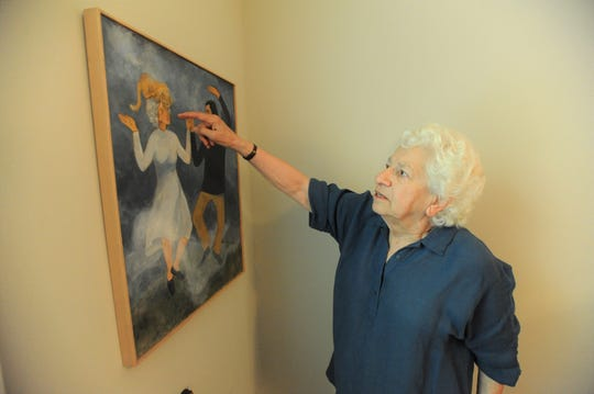 A painting depicting Nonny Hogrogian, her husband David Kherdian and the cat they kept as a pet for 18 years, hangs in the couple's Black Mountain home. Hogrogian and Kherdian will hold a reading at the Black Mountain-Tyson Library on June 6.