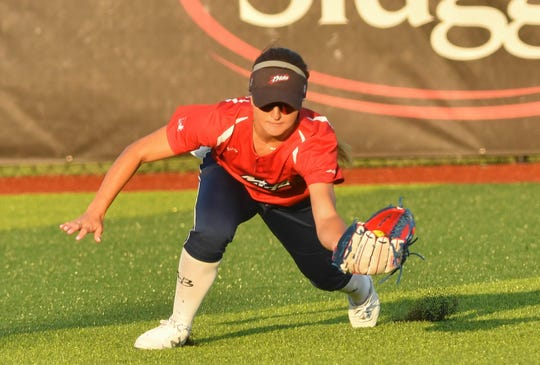 USSSA Pride Allexis Bennett dives for a ball during Thursday's exhibition game against the Czech National Team.