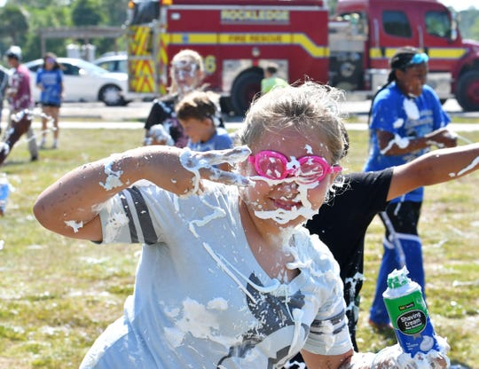 "The last day of public school in Brevard ended with celebrations, including the annual Team Grace ""Shaving Cream Blast"" party at Larry L. Schultz Park in Rockledge. To add to the fun, the Rockledge Fire Dept. created a water shower with a sprinkler and fire hose. Kids from several schools and grads participated. Team Grace is a community outreach for children and adults of all abilities. For more info, email teamgraceinbrevard@gmail.com."
