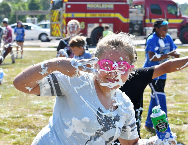 """The last day of public school in Brevard ended with celebrations, including the annual Team Grace """"Shaving Cream Blast"""" party at Larry L. Schultz Park in Rockledge. To add to the fun, the Rockledge Fire Dept. created a water shower with a sprinkler and fire hose. Kids from several schools and grads participated. Team Grace is a community outreach for children and adults of all abilities. For more info, email teamgraceinbrevard@gmail.com."""