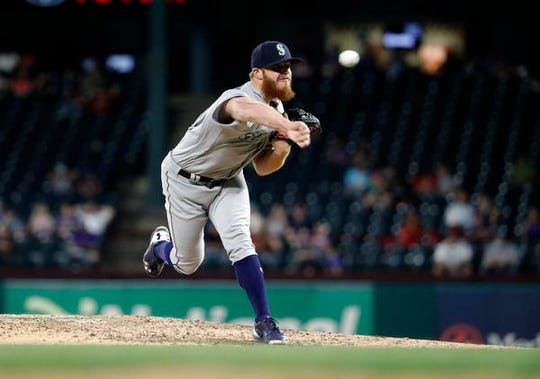 Seattle Mariners David McKay throws the first pitch in his Major League debut in the eight inning of a baseball game against the Texas Rangers in Arlington, Texas, Monday, May 20, 2019. (AP Photo/Tony Gutierrez)