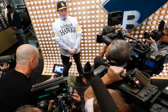 SoftBank Hawks pitcher Carter Stewart Jr. of Eau Gallie High poses during a baseball news conference in Newport Beach, Calif., Thursday, May 30, 2019. After failing to sign with Atlanta and losing a grievance against the Braves, 19-year-old right-hander Carter Stewart has agreed to a six-year contract with the Fukuoka SoftBank Hawks of Japan's Pacific League. (AP Photo/Chris Carlson)