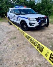 A Bee County Sheriff's Office patrol vehicle blocks part of a road near Ridgeway Lane in Bee County.